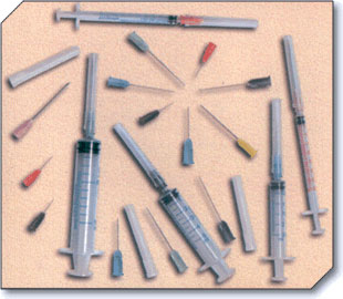 Disposable syringes and needles